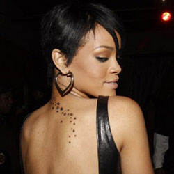 Rihanna Stars Tattoo Rihanna comes to the Defense of Man Downs Gory Visuals